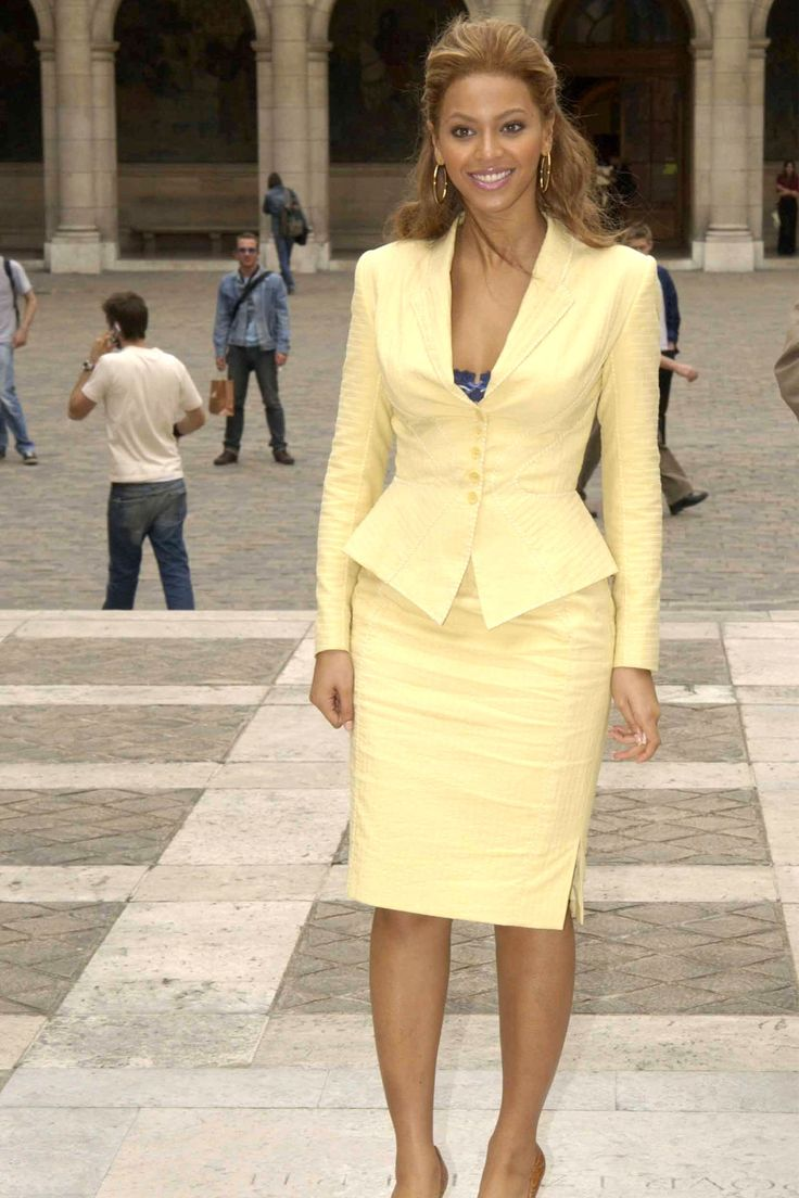 Beyonce at photocall for her firlm The Pink Panther, wearing a primrose skirt suit