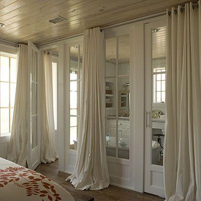 Southern Living - bathrooms - en suite, en suite bathroom, glass doors, bathroom glass doors, wall of glass doors, floor to ceiling curtains...