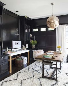 """Installing picture frame molding added instant dimension to the plain walls. """"It also establishes order on a wall broken up irregularly by windows and doors,"""" says Hidalgo-Nilsson. The trim is repeated on the built-ins, which hide file cabinets, printers, and drawers."""
