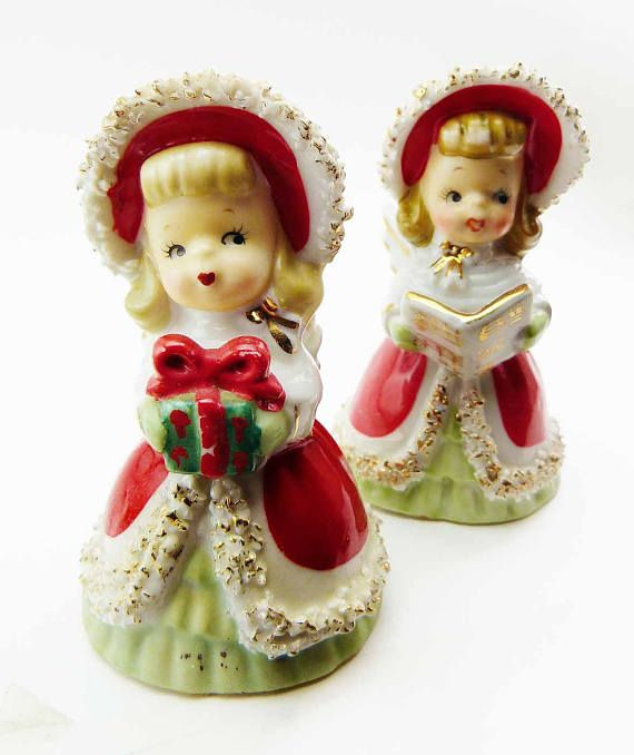 Set of 2 (two Christmas Holiday Figural Angel Bells Manufacturer: Lefton China. Made in Japan Circa 1950s One angel figurine is holding Gift and the other is singing, holding Sheet Music. Spaghetti Trimmed Porcelain. Red Green Gowns Hand Painted Features (including gift, sheet music faces with hand rendered accents to the overall design)  The porcelain figurines measure about 4 3/8 inches x 3 inches Condition: EXCELLENT. No breaks, chips, crazing - fantastic features & hand painting....