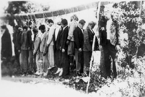 Kladorahi, Greece, The execution by hanging of 15 Greeks. Among the hanged are 2 Jews, Nissim Batish from Joanina (father of the submitter) and Aron Levi from Trikkala.