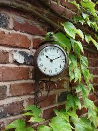 Large Outdoor Garden Paddington Station Wall Clock traditional-outdoor-clocks