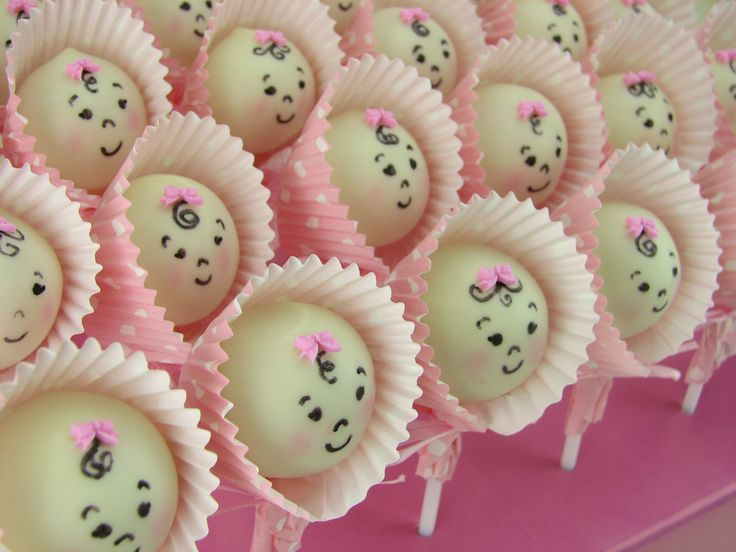 Cute baby girls for a baby shower made of vanilla cake pops covered in white chocolate.