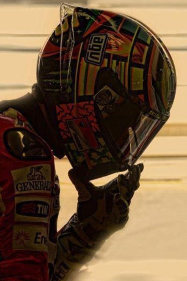 valentino rossi--looks like he's in his Ducati leathers (circa 2011/2012).
