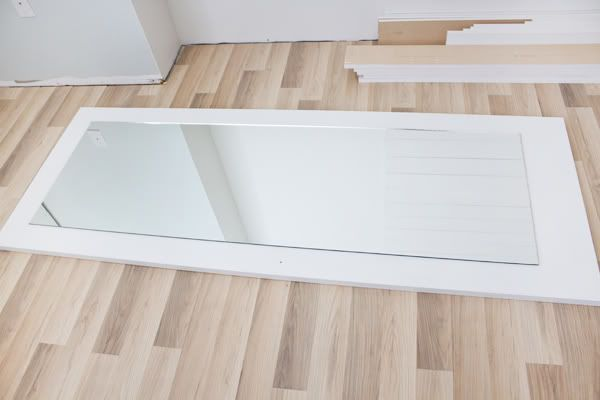 DIY- glue mirrors on to standard paneled doors. So Easy. Master Bedroom Closet Door Re-do Project   The Lettered Cottage
