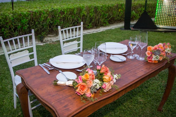 Use the bridesmaid's bouquets as the perfect floral touch to the sweetheart table here at Zöetry Paraiso de la Bonita! #DestinationWedding #FloralDecor #FlowerIdeas