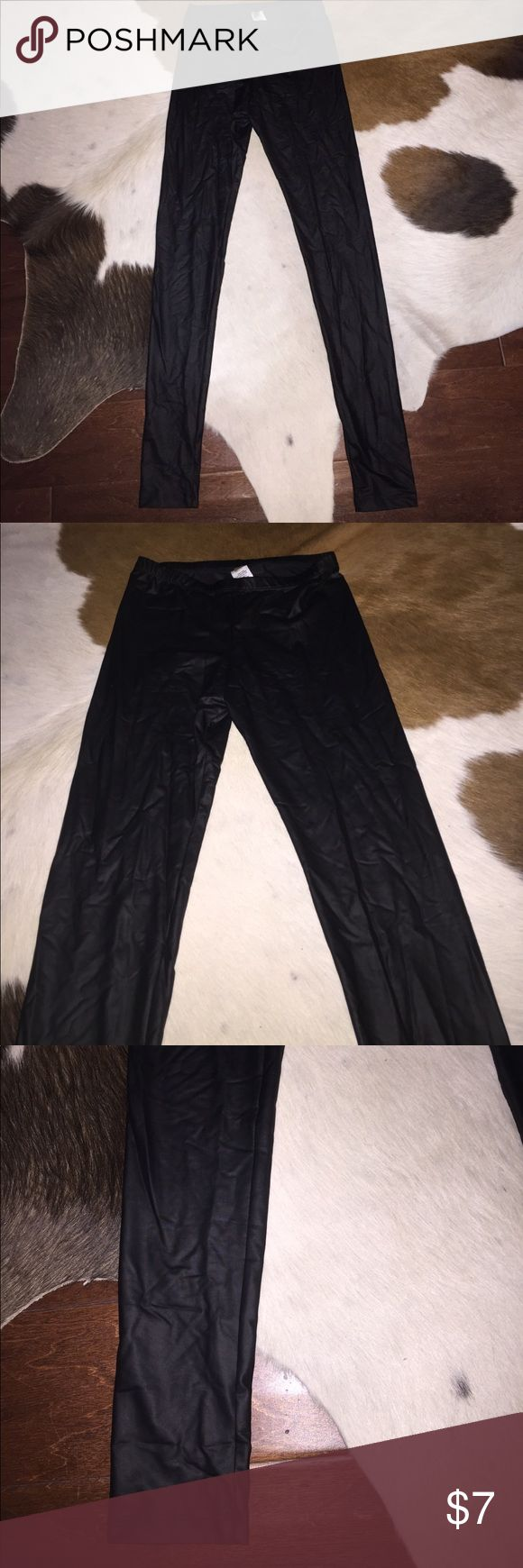 Never Worn Faux Leather Leggings - Size Medium Cherish NWOT Faux Leather Leggings. Size Medium. Fits me. I am a size 6/8. Skinny style. All items have been pre owned, lightly used, NWOT or NWT. They come from a smoke free home. I can not promise items are in perfect condition but they have been cared for extremely well. If there are issues please read the description and look at the images posted. If you have questions please ask. Thank you! Cherish Pants Leggings
