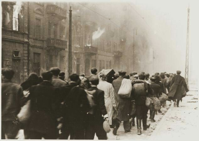 Jews captured during the Warsaw Ghetto Uprising are marched off through a debris-covered street to the Umschlagplatz for deportation.  Photo credit: Poland National Archives