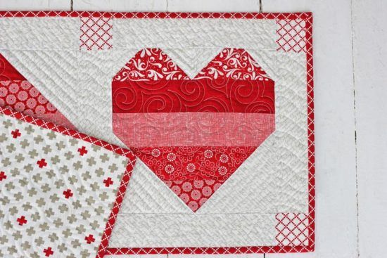 Hi! This is Kristina Brinkerhoff from Center Street Quilts and I'm excited to share a Valentine's Day project with you today: Jelly Roll Hearts Table Runner! I enjoy working on h…