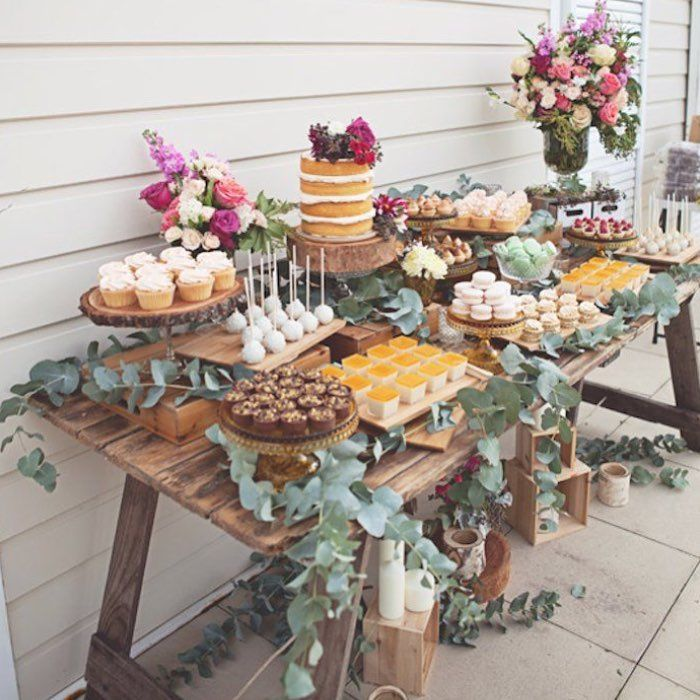 A rustic dessert table for a secret garden themed bridal shower! The bright flowers add a whimsical touch!✨ {Inspired by @karaspartyideas}