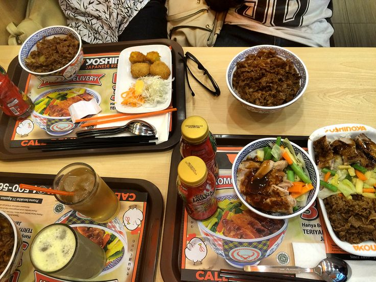the table is full of bento from yoshinoya malang | place : yoshinoya malang town square, 4th floor