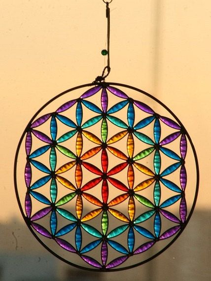 WOW!!  Stained glass, some hoopla (it would be my first!)...  Flower of Life Sahasrara Sacred geometry Suncatcher by Mownart, $32.00