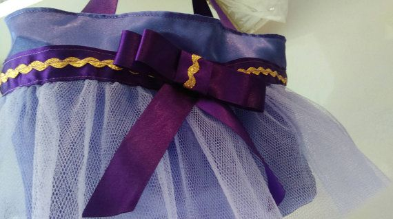 A cute purple satin tutu princess bag. Measures approximately 26x27cm and has two small handles. A matching dress up princess apron is also available.  This item is custom made to order so please allow 2 weeks for making and then upto a week for delivery. Orders will be posted using myHermes and a tracking number will be supplied once dispatched.