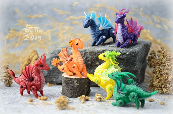 Mini Dragons - Rainbow by dallia-art Dragon with moving legs and wings. Height and length vary from 3.5 cm to 5 cm. Colored polymer clay, no paint.