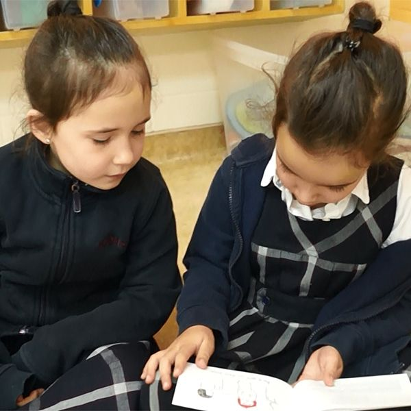 INSTRUCTION: In this activity, students read Bob Books (predictable or decodable books) elbow to elbow and knee to knee with a partner. This activity is effective as practicing reading appropriate levelled books builds reading fluency. As well, it is motivating as there is a purpose behind reading aloud: reading to a friend!
