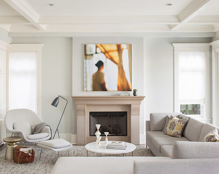 Serene whites, neutrals, and maybe the palest mint colour on the wall, modern concrete stone fireplace wtih minimal mantel. Love the womb chair and the round ottoman. House by Terris Lightfoot Contracting and Kelly Deck Design in Toronto Canada.