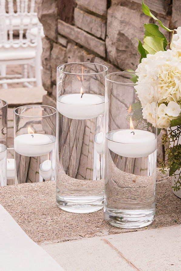 These multi-use 10 inch glass cylinder vases are the perfect table decoration that can be used as floating candle holders or even a floral vase. The functionality of these classic vases makes them versatile and reusable, and a necessity for any party or occasion. Find these candle holders here: http://myweddingreceptionideas.com/10_inch_glass_cylinder_vase.asp