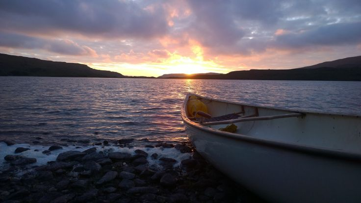 Sunset from quiet beach accessed by canoe, Loch Lurgainn