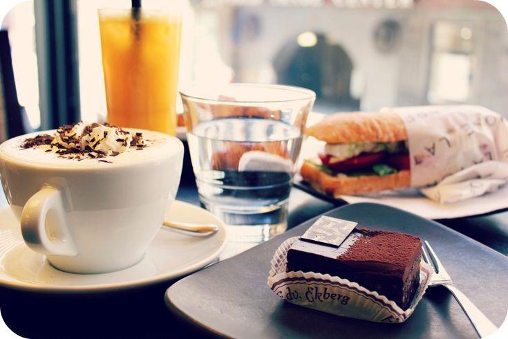 A dream breakfast: orange juice, cappuccino, chocolate cake and baquette with fresh fill.