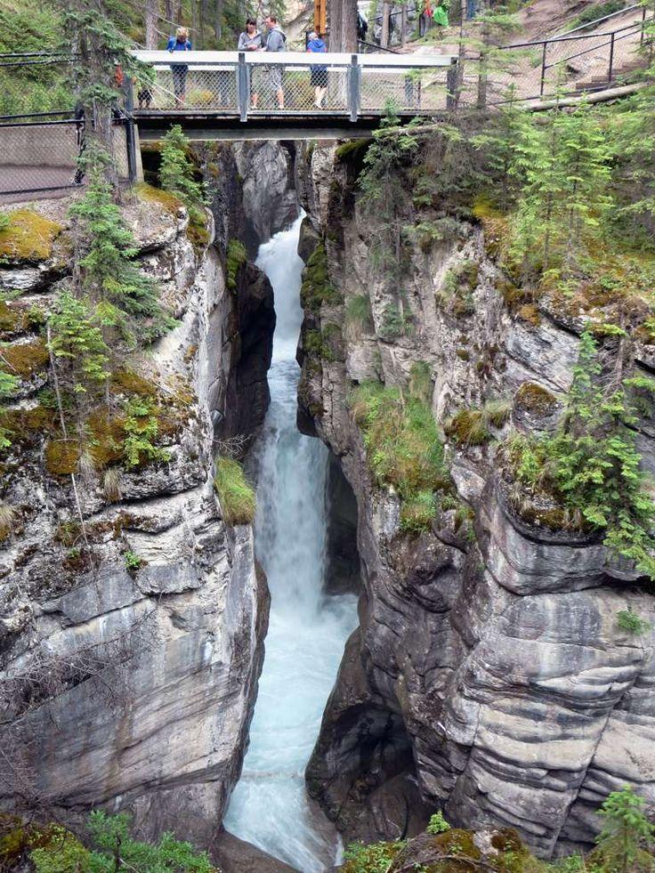 The Maligne River rushes through a deep limestone gorge at Maligne Canyon near Jasper, Alberta, Canada.