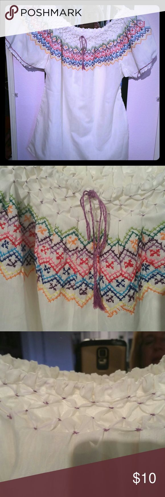 BOGO Hand embroidered Mexican shirt Lovely cotton blouse hand embroidered and smocked (front and back), bought in Mexico many years ago. Has just been residing in my closet and it's now a bit small for me. I would say it fits a small or small medium size woman. Embroidery is detailed and really lovely. Some very minor pilling but otherwise very good condition. Comes from nonsmoking home and I ship quickly. This weekend only -- buy any $10 or less item and get one free. Just message me what…