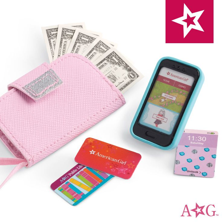 New Truly Me Doll accessories include: wristlet with pockets, pretend cellphone, pretend library card, pretend AG gift card, pretend dollar bills.