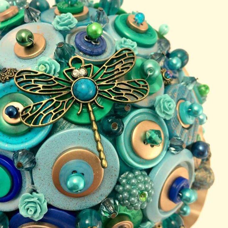 peacock nouveau button bouquet close up