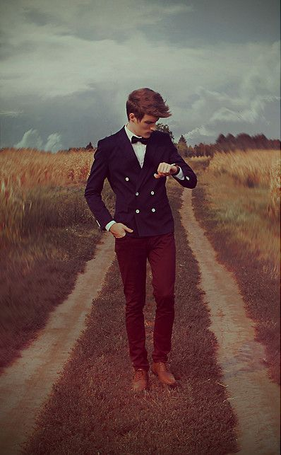 navy jacket, maroon pants, bow tie, brown leather shoes.