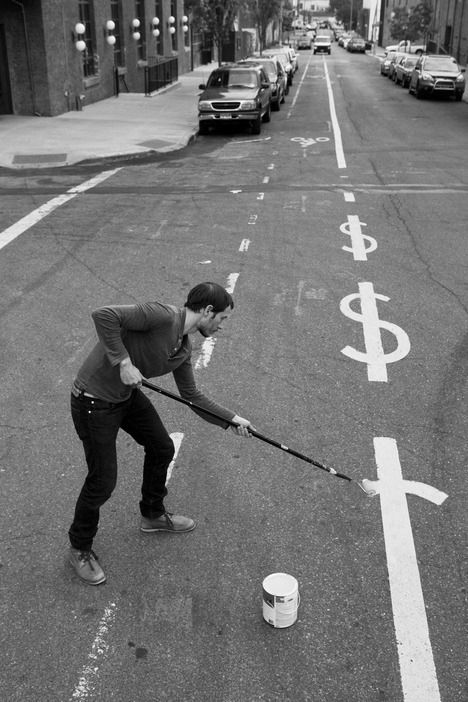 funny black white picture about man in street making dollars