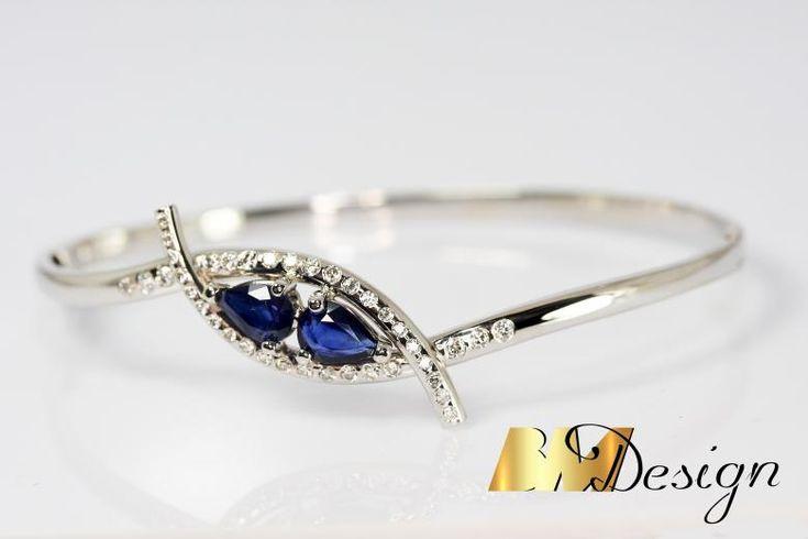 Bransoleta z szafirami i diamentami z białego złota. Sztywna, rozpinana bransoleta z kamieniami naturalnymi BM Design Rzeszów. Biżuteria na indywidualne zamówienie Autorska Pracownia Złotnicza BM #bransoleta #szafir #diament #na zamówienie