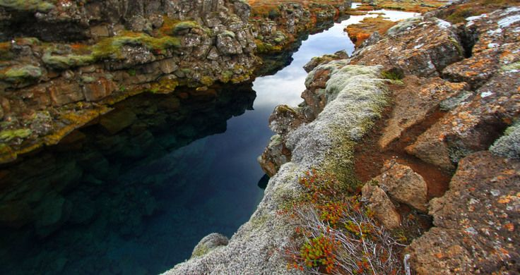 This natural Icelandic fissure allows divers to swim right between two volatile tectonic plates