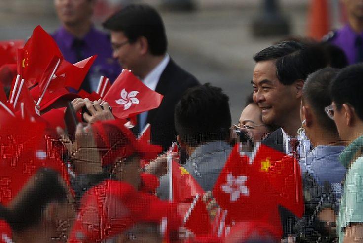 Leung Chun Ying smiling and greeting.