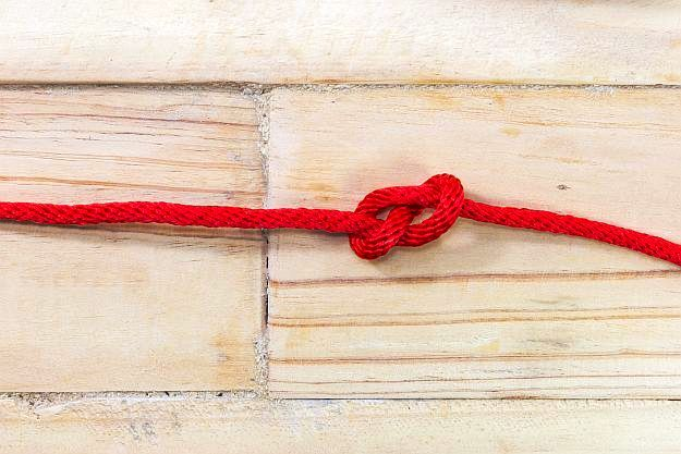Step 2: Tie A Knot | How to Make A Popcorn Garland For Fun Free Holiday Decor