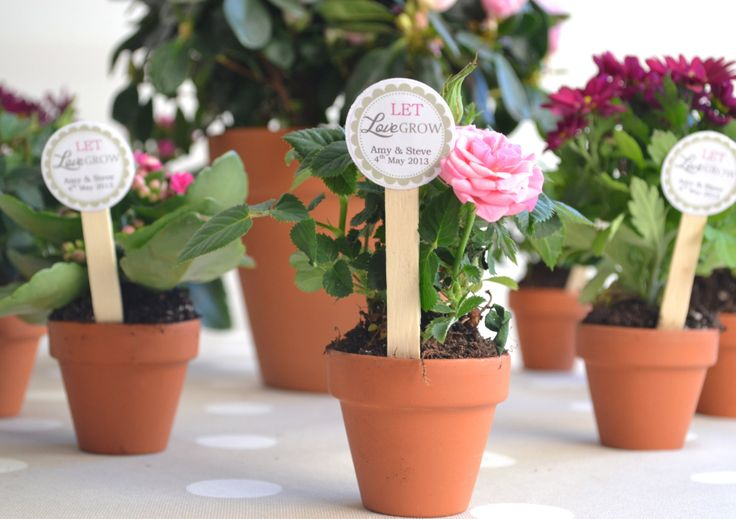 Mini flower pot DIY favors - 10 x terracotta plant pots with personalised labels & wooden stake. Wedding favours. £14.50, via Etsy.
