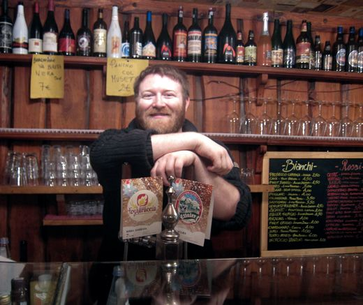 Sebastiano, the owner, and his beloved tap beers!
