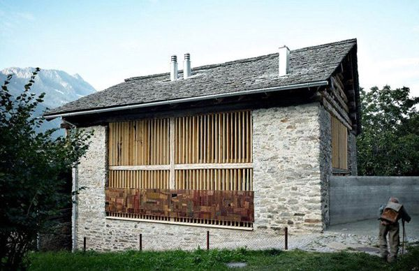 This old barn conversion by local architecture firm Ruinelli Associati Architetti takes this peaceful, bucolic setting by storm, though not immediately vis