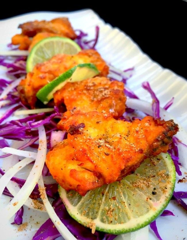 Amritsari Fish (Indian style battered fish) is a lightly battered fish fry in Indian flavors. It's crunchy and light to eat. Works great as appetizer.