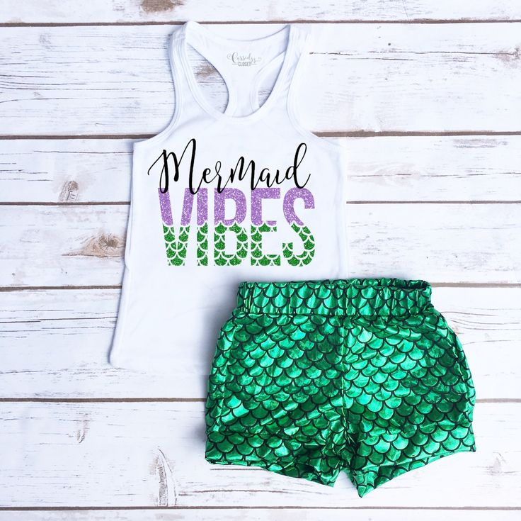 Mermaid Vibes Summer Toddler Girl Outfit. Adorable Racerback Tank printed in glitter purple and green with matching Green and Black Mermaid Scale Shorties.