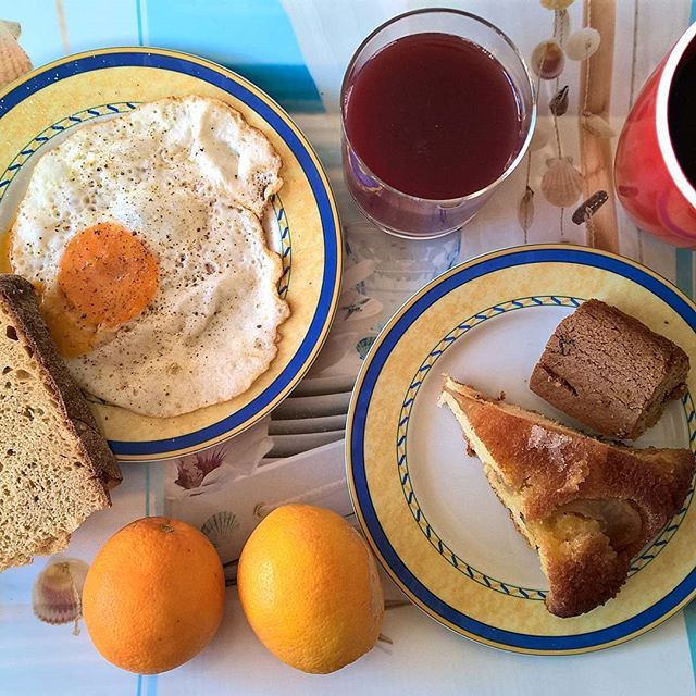 "On Fridays: A fried egg (with the yolk broken to help the dipping) with a slice of sourdough, a piece of her apple pie, a piece of ""fanouropita"" and the first couple of oranges from our garden. #thenewbreakfasteverydayproject #livingmylifemyway"
