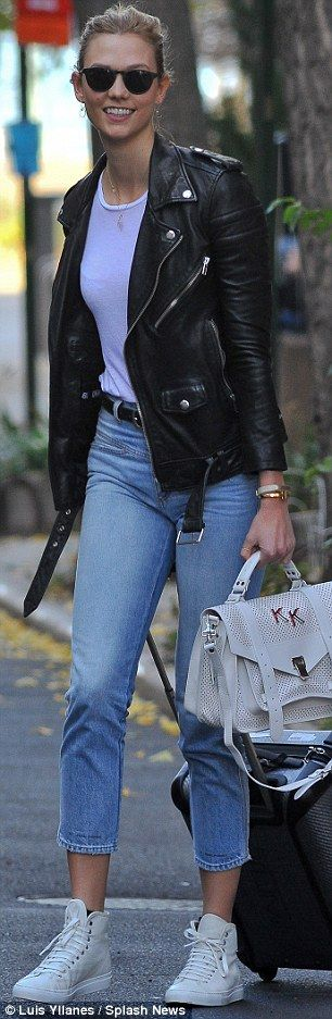 Indecision: Karlie Kloss couldn't decide between a classic grey coat and an edgy biker jacket while out and about on Wednesday in New York City