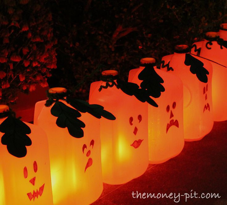 lighted milk carton jack o laterns a great border along the side walk - Milk Carton Halloween Ghosts