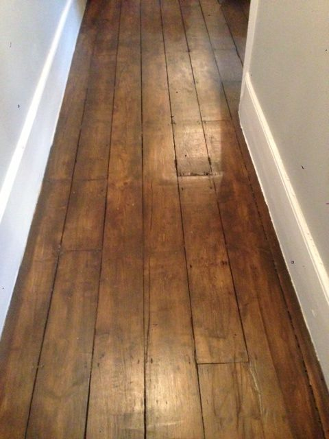 Sanded and oiled pine floor boards to a dark oak colour.