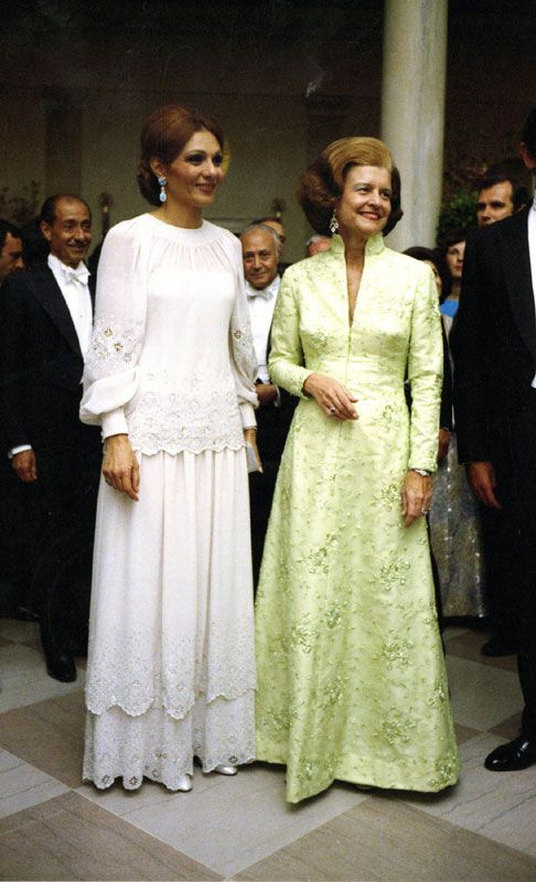 Betty Ford and Farah, shabanou of Iran, 1975  Both ladies wore modest, simple gowns that were flattering.