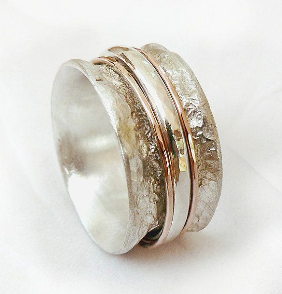 Wedding ring. A sterling silver ring with two 9k red or yellow gold spinner hoops and a thick sterling silver hoop. It can be a wonderful wedding ring. The sterling has an amorphous texture that looks like crumpled tinfoil  Measurements: width 11.5mm / 0.46 inch thickness- 3mm / 0.12 inch  The spinners can be silver or 9k red or yellow gold if you wish.  This listing is for sizes 5-11- Just convo me your size. For other sizes - please convo me.  All my jewelry is handmade by me, every piece…