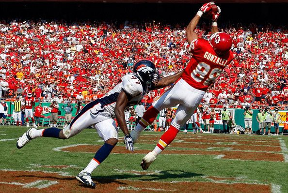 Boss Bailey Tony Gonzalez #88 of the Kansas City Chiefs catches a pass in front of Boss Bailey #97 of the Denver Broncos on September 28, 2008 at Arrowhead Stadium in Kansas City, Missouri.
