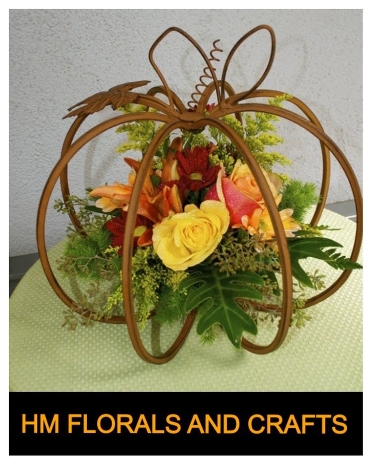 A repurposed candleholder shows off flowers for Halloween or Thanksgiving!