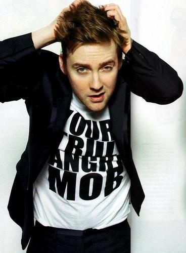 """Ricky Wilson - hearing lots of people saying """"He got hot"""" well this picture was taken in 2007 when Kaiser Chiefs 2nd album Your's Truly, Angry Mob came out, that's what it says on his tshirt - so he was always hot, people just didn't notice him :p"""