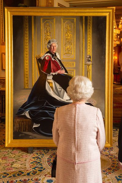 Queen Elizabeth II Photos Photos - Queen Elizabeth II views a portrait of herself by British artist Henry Ward, marking six decades of patronage to the British Red Cross, which has been unveiled at Windsor Castle on October 14, 2016 in Windsor, England. The Queen is the longest-serving patron of the charity, which supports people in crisis in the UK and overseas. - The Queen Unveiles Her Portrait Marking Six Decades Of Patronage