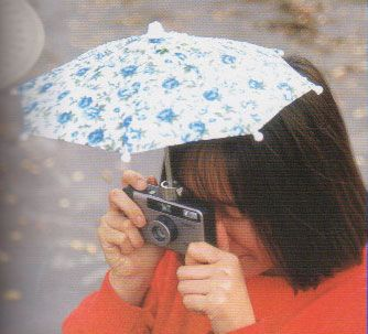 camera umbrella | Funny and Strange Japanese Inventions | The Design O'Blog