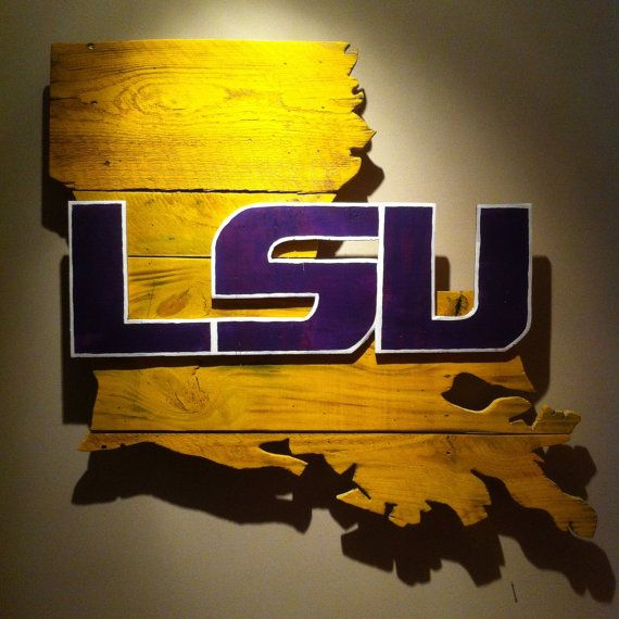 Handcrafted wooden state of Louisiana with LSU lettered logo made from pallet wood.    The products displayed on this website are not